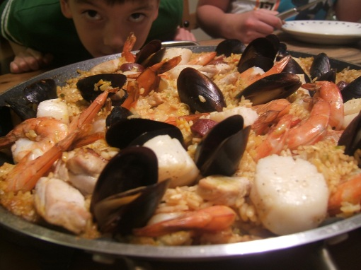 Our Saturday paella with son inhaling paella's distinctive aroma